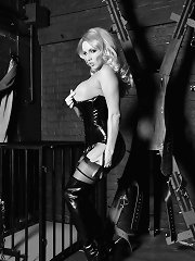Stunning golden-haired in pvc leather licking her long darksome cane