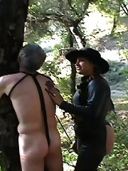 Cowgirl whips bandit under obligation to tree