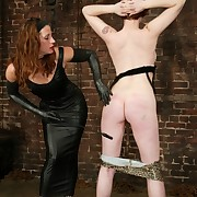 Mistress in leather spanking and fucking slavegirl