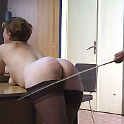 Hard caning of mature slut