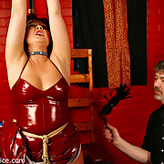 Babydoll in red latex suspended, whipped and gaged
