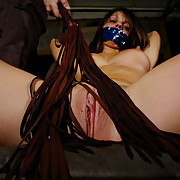 A tied girl was flogged wide of lash