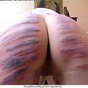 Pretty young girl restrained over a desk and brutally caned to tears