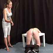 Salacious broad gets spiteful spanks on her rump