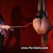 Juicy nude babe under harsh whip lashes out of reach of ass and pussy in cruel headdown suspension