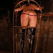 Alex suspended with an increment of caged of a severe earthling punishment with riding crop with an increment of dogwhip