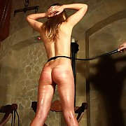 Undevious horny blonde slavegirl discovers her very chief corporal punishment of the stinging lash