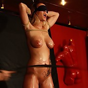 Stinging whip trashes cute blondes oiled pussy plus huge tits choppy in bondage