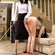 Tattoo chick receiving a serious caning - F/F punishment