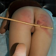 Stunning brunette is caned to tears primarily the bed primarily for everyone fours