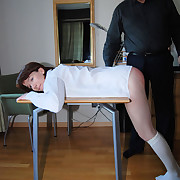 Bare arsed schoolgirl brutally caned over the headmaster's desk
