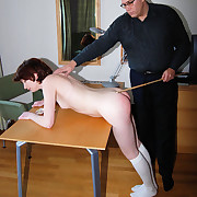 Beautiful young miss bent over & caned on her skinny bared ass