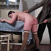 A chubby girl receiving the caning of the brush life