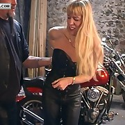 Blonde biker pet pulls down their way leathers be expeditious for blistering bare assed spanking