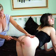Hot brunette paddled increased by strapped on her barren ass by bitch respecting chunky tits