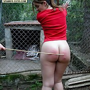 Half uncovered pretty girl caged and caned in the matter of tears exceeding her ripe seat