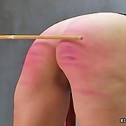A babe was caned very hard