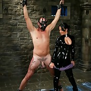 Sandra Romain worn in dark latex is fucked her slaveboy`s arse hard