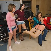Two girls watch a brunette get spanked