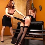 Hard in nature's garb bottom spankings for 2 wicked nubiles over the bench