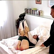 Schoolgirl was caned on the bed