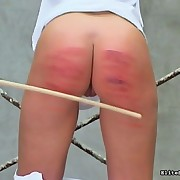 A hawt chick having her ass caned