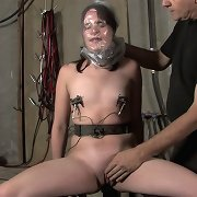 She\'s belted animal training the neck, wrists, elbows, waist, and ankles into a metal chair.