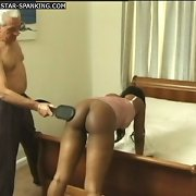 Chubby swarthy gal is caned on her big round ass