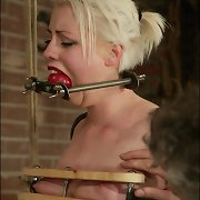 Gagged golden-haired with tied arms behind