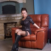 Candi licks her leather boots before she puts them on