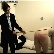 Black beauty spanked & caned on her large luscious arse