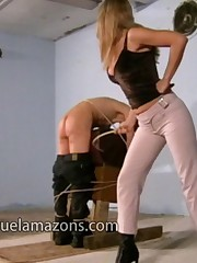 Blonde domina spanked male slave