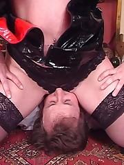 Fetish wife sits on husband