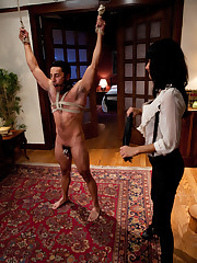 Slave's dick is locked and he is fucked with strap-on