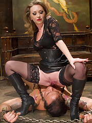 The dominatrix wanked slave`s cock, got her boot liked and sitting on his face