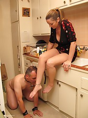 Husband is licking wife`s toes on the kitchen
