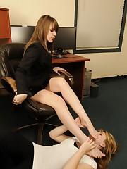 Lady boss dominate her female secretary by feet