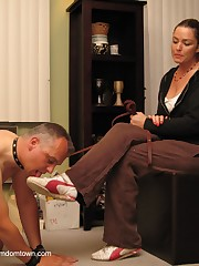 Mistress dominates a malesub by feet