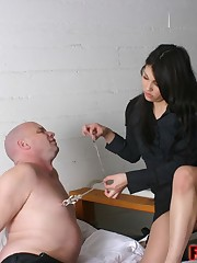 Domina torments nipples of malesub and then tramples him