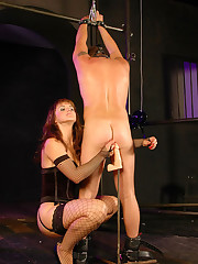 Femdom bitch lashes her slave and fucks his tight ass with a big dildo on a stick