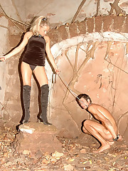 Blonde mistress punishes her handsome slave outdoors with genital bondage and ass whipping