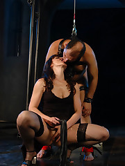 Unmerciful mistress fucks mature slave with a dildo and makes him worship her nyloned feet