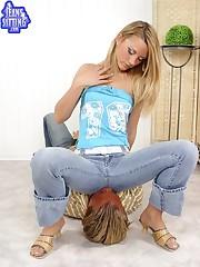 Sexy blonde mistress sat on slave