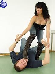 Brunette girl sat on slave's face