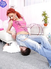 Hot redhead in jeans sat on slave`s face