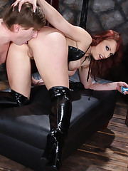 A fetish dome has her ass and leather booted feet worshipped