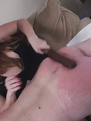 Sexy blond was spanking very hard her slave's ass.