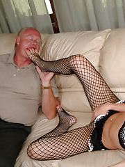 Girl in fishnets footjobs foot fetishist's dick