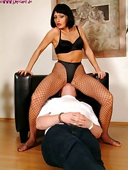 Brunet slut in sexy lingerie straddled man's face.