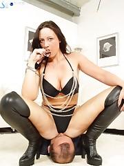 Mistress in black sat on slave